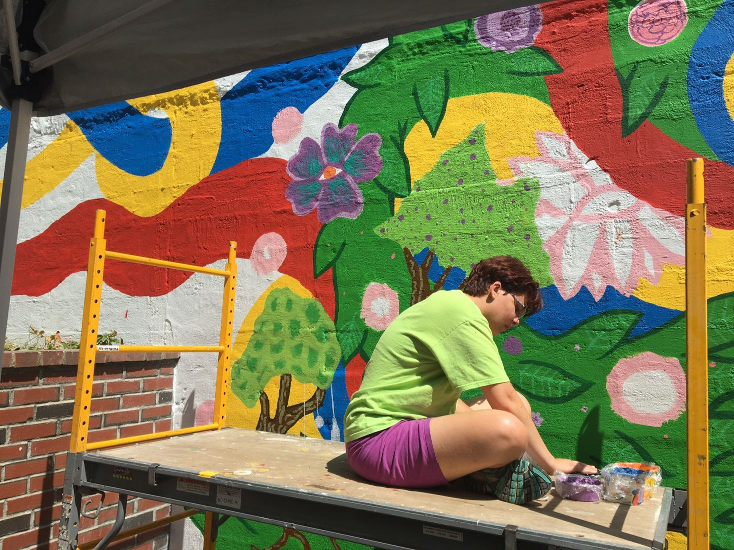 AIR teen, Lauren Brown working on the Teatotaller's mural in downtown Somersworth